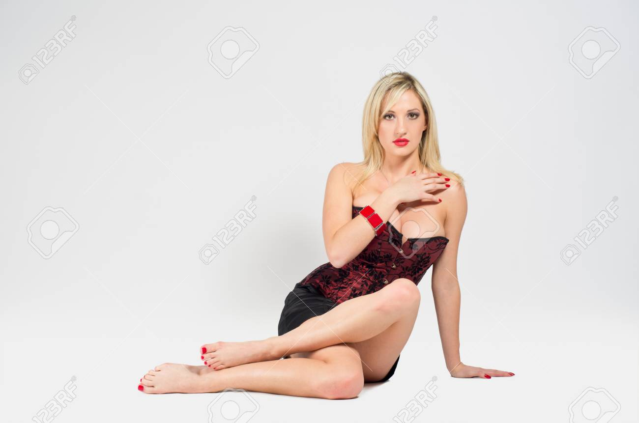 Attractive sexy young caucasian blonde woman sitting on the floor Stock Photo - 12646815