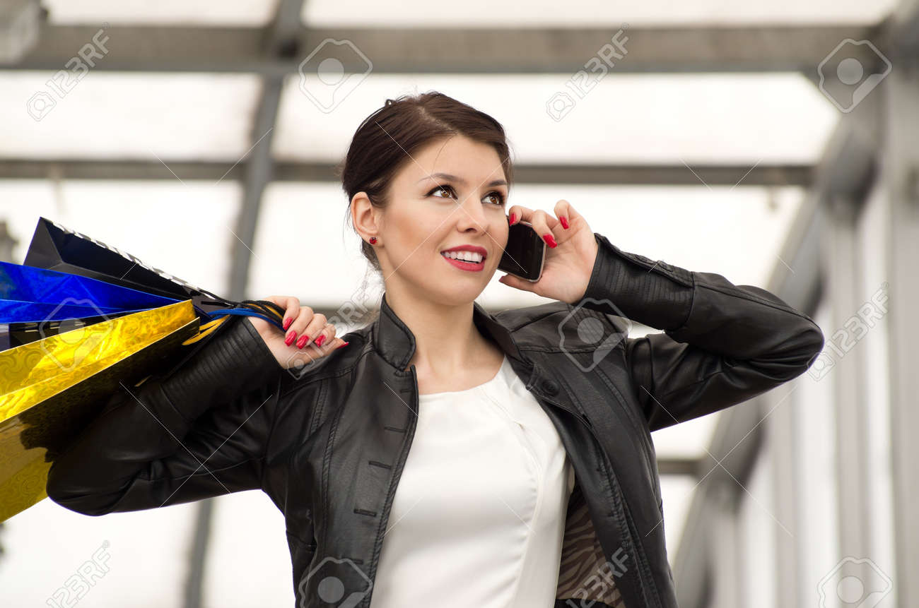 Portrait of beautiful caucasian brunette woman with colorful shopping bags Stock Photo - 13351914