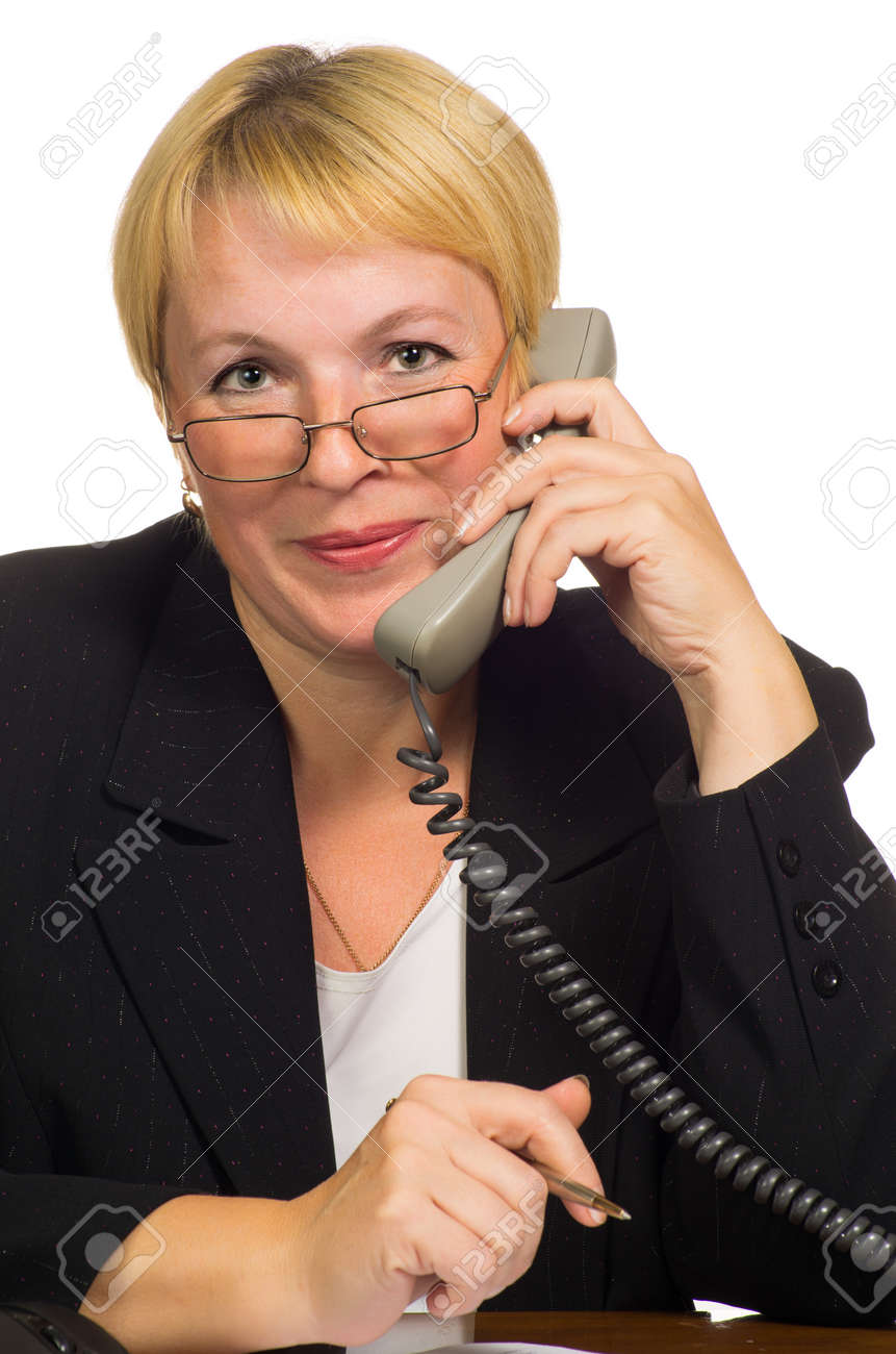 Mature businesswoman calling on the phone at her workplace  Isolated against white background Stock Photo - 15422025