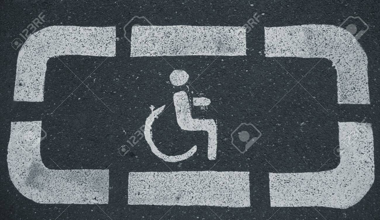 Handicap parking areas reserved for disabled people Horizontal background - 147965793