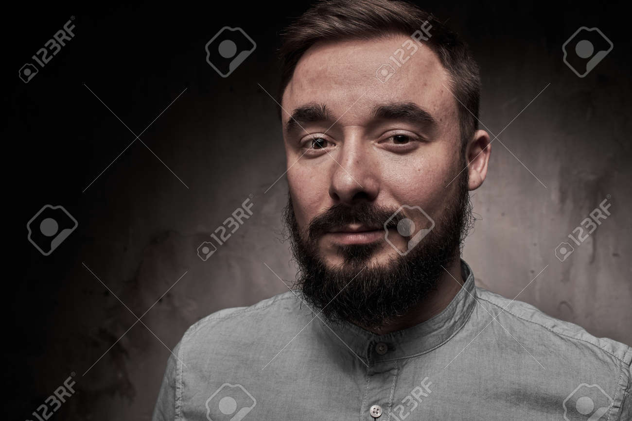 A handsome young man with a beard. The emotions of a man. Depression or hopelessness. Dramatic emotional portrait of a man. High quality photo - 166563134