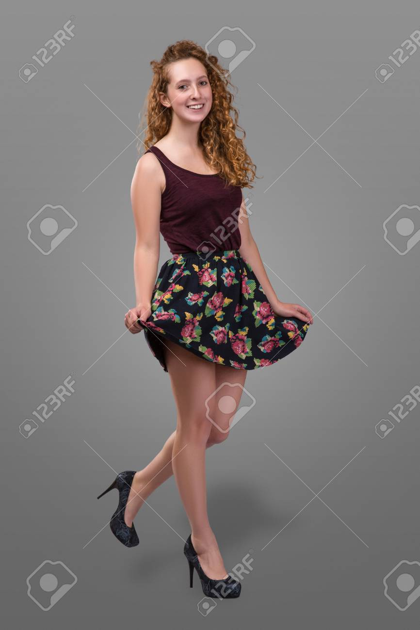 b937f5fbbc5ce pretty plus size young redhead and curly-haired girl wearing short skirt  with floral print