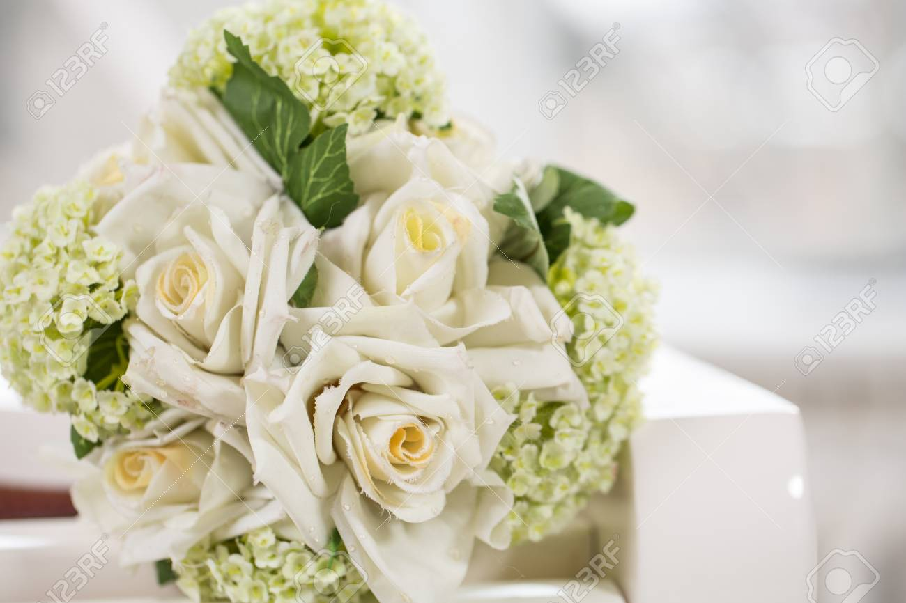 Wedding Bouquet Made Of White Roses Artificial Flowers In Dew Stock