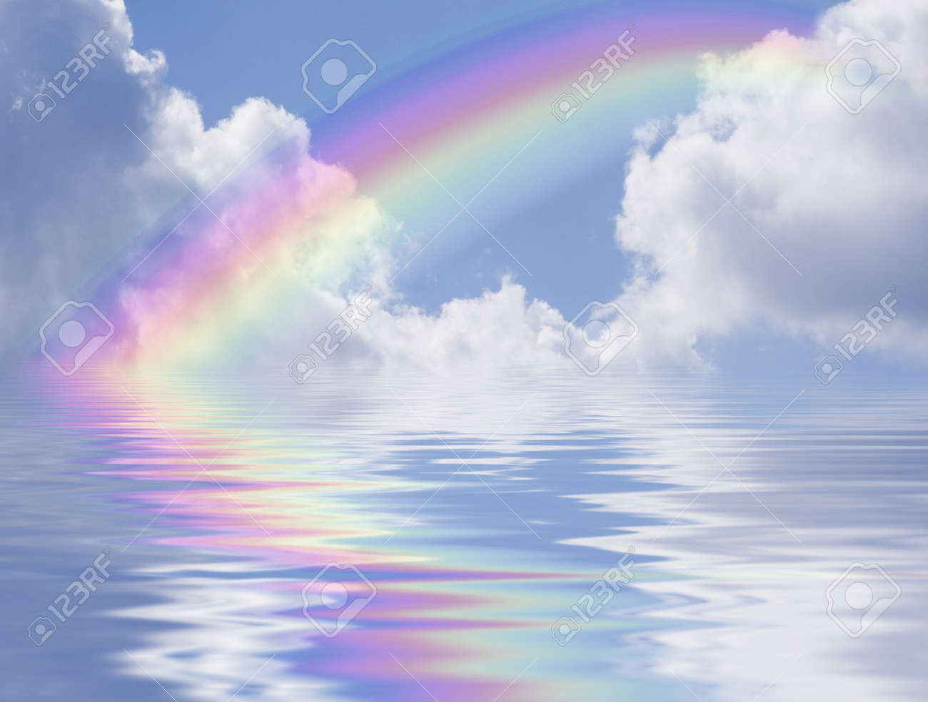 blue sky with rainbow and clouds reflected in the water stock photo