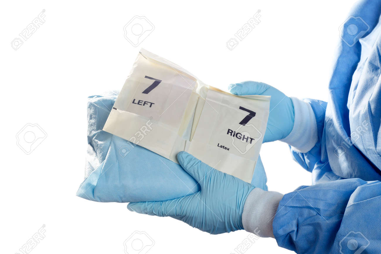 Operating Room Technician Holds Gown And Gloves For Surgeon. Stock ...