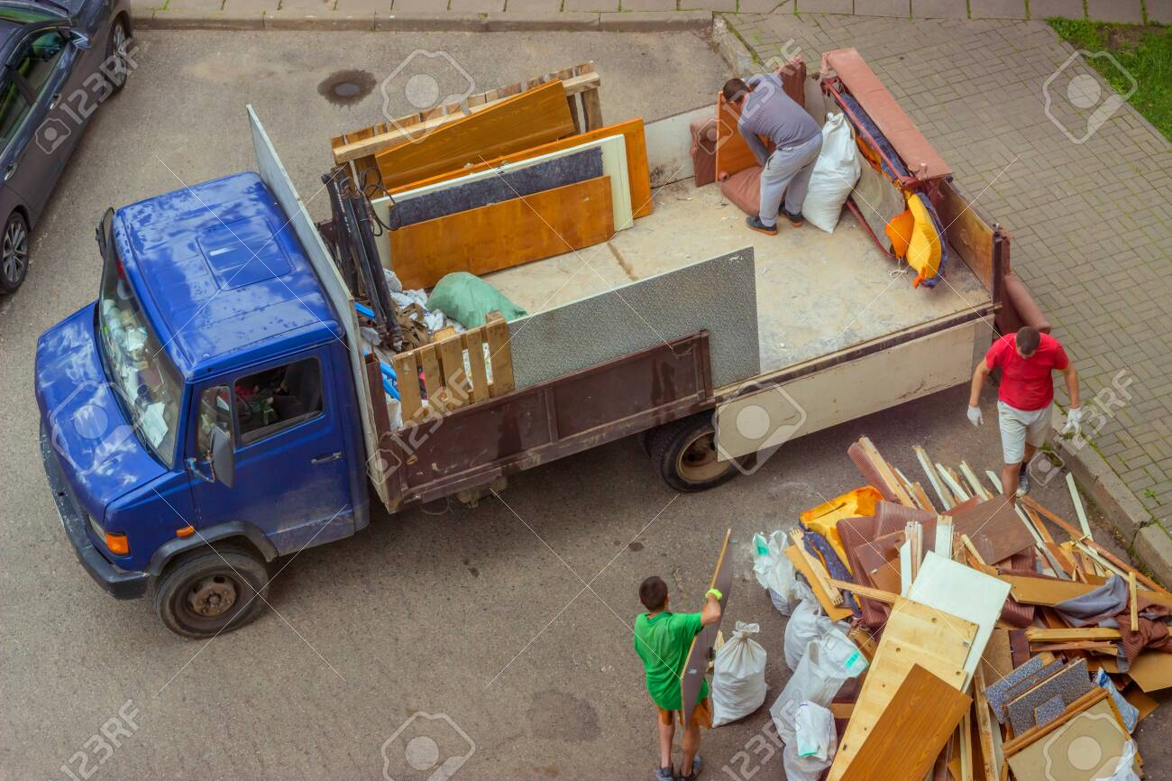 Workers Load Old Furniture Into The Back Of A Truck To Transport Stock Photo Picture And Royalty Free Image Image 153938912