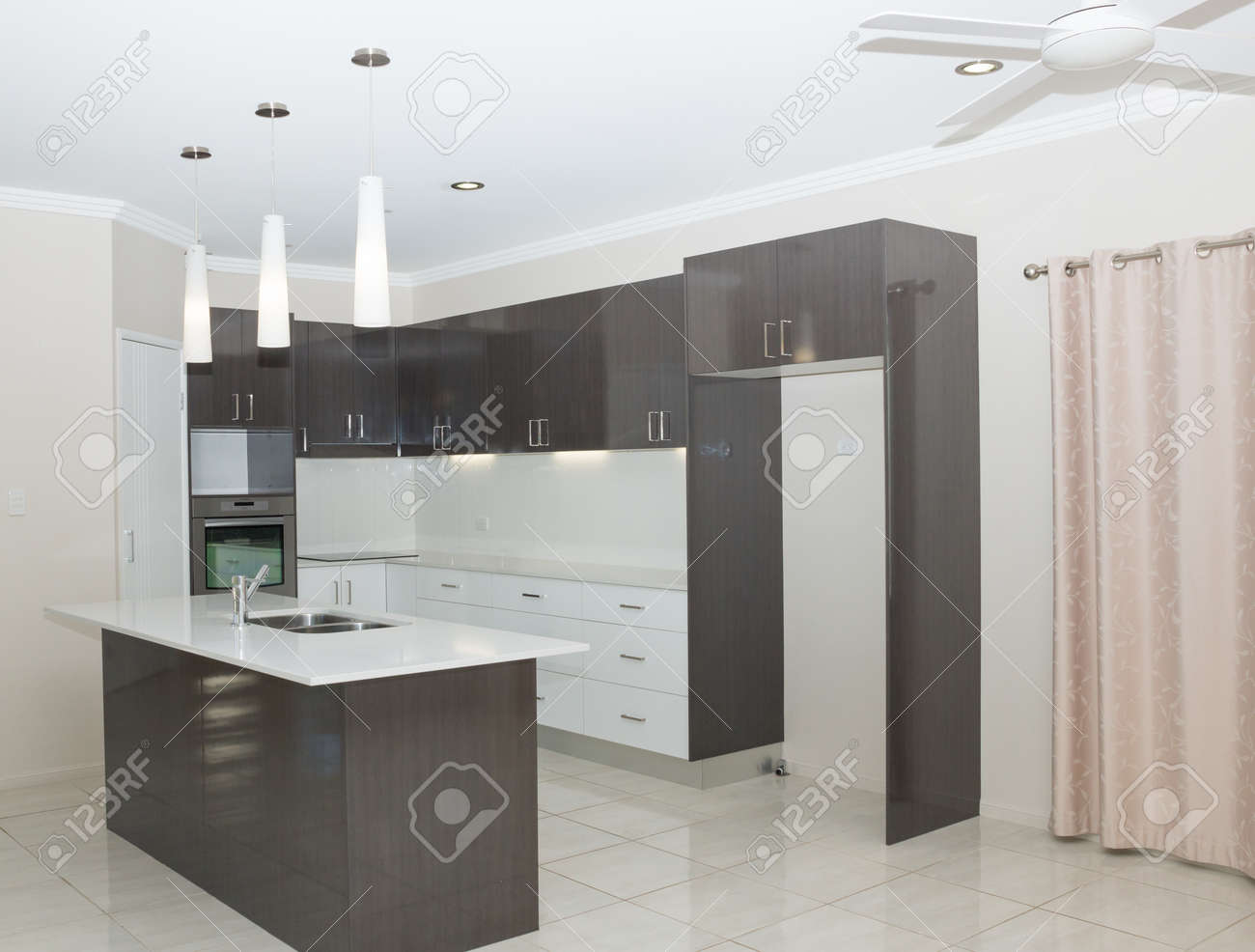 New Modern Kitchen With Island Bench And Hanging Lights Stock Photo Picture And Royalty Free Image Image 72156038