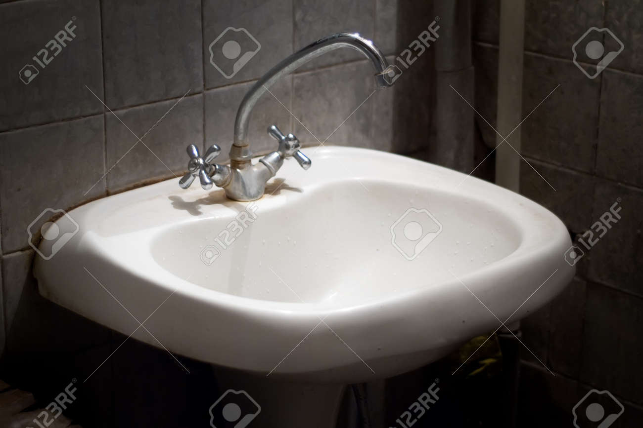 old dirty smelly sink in a dirty toilet Stock Photo - 7560680