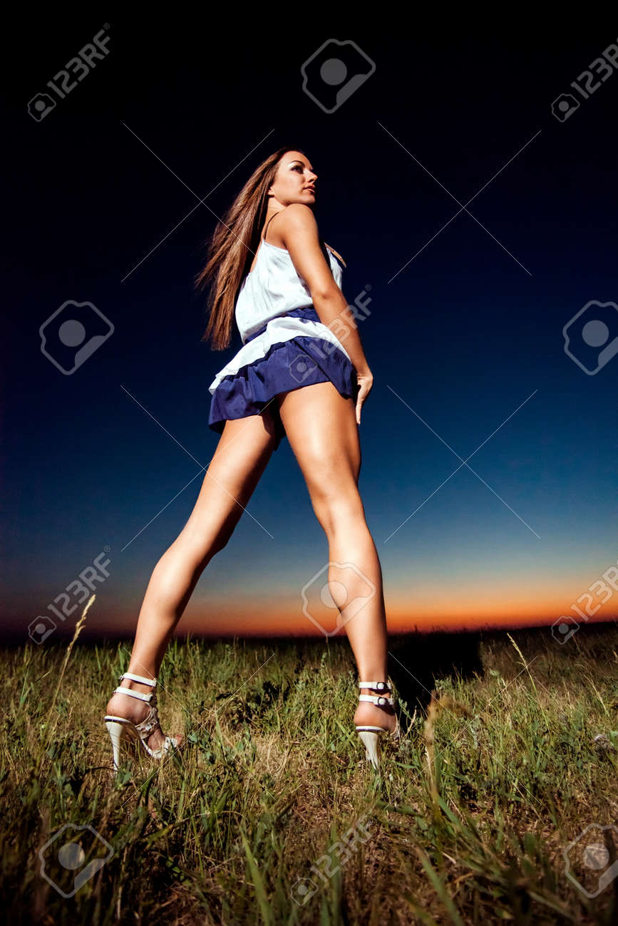Girl With Long Legs In Short Skirt Stock Photo, Picture And ...