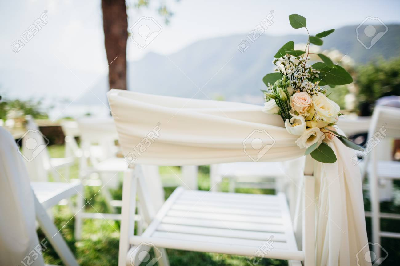 Wedding Chair Cover With Flowers Decoration At Destination