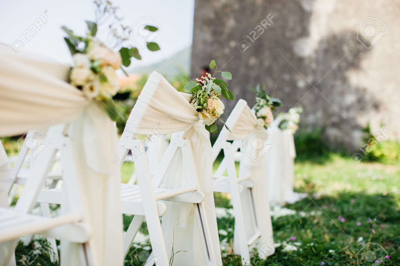 Wedding Chair Covers.Wedding Chair Cover With Flowers Decoration At Destination Wedding