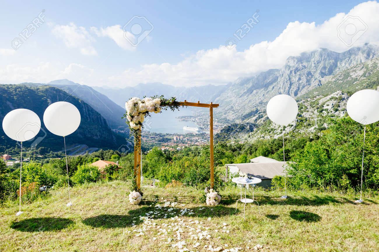 Wedding arch with wedding decoration and sea view picturesque stock photo wedding arch with wedding decoration and sea view picturesque wedding location with balloons in fine art style junglespirit Images