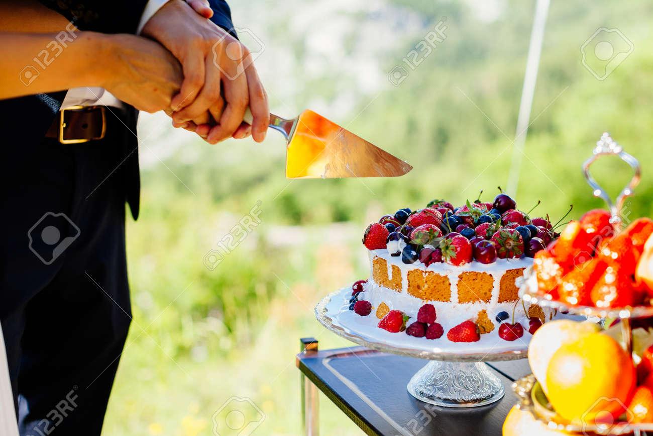 Bride And Groom Cut Wedding Cake. Close Up. Fine Art Wedding.. Stock ...