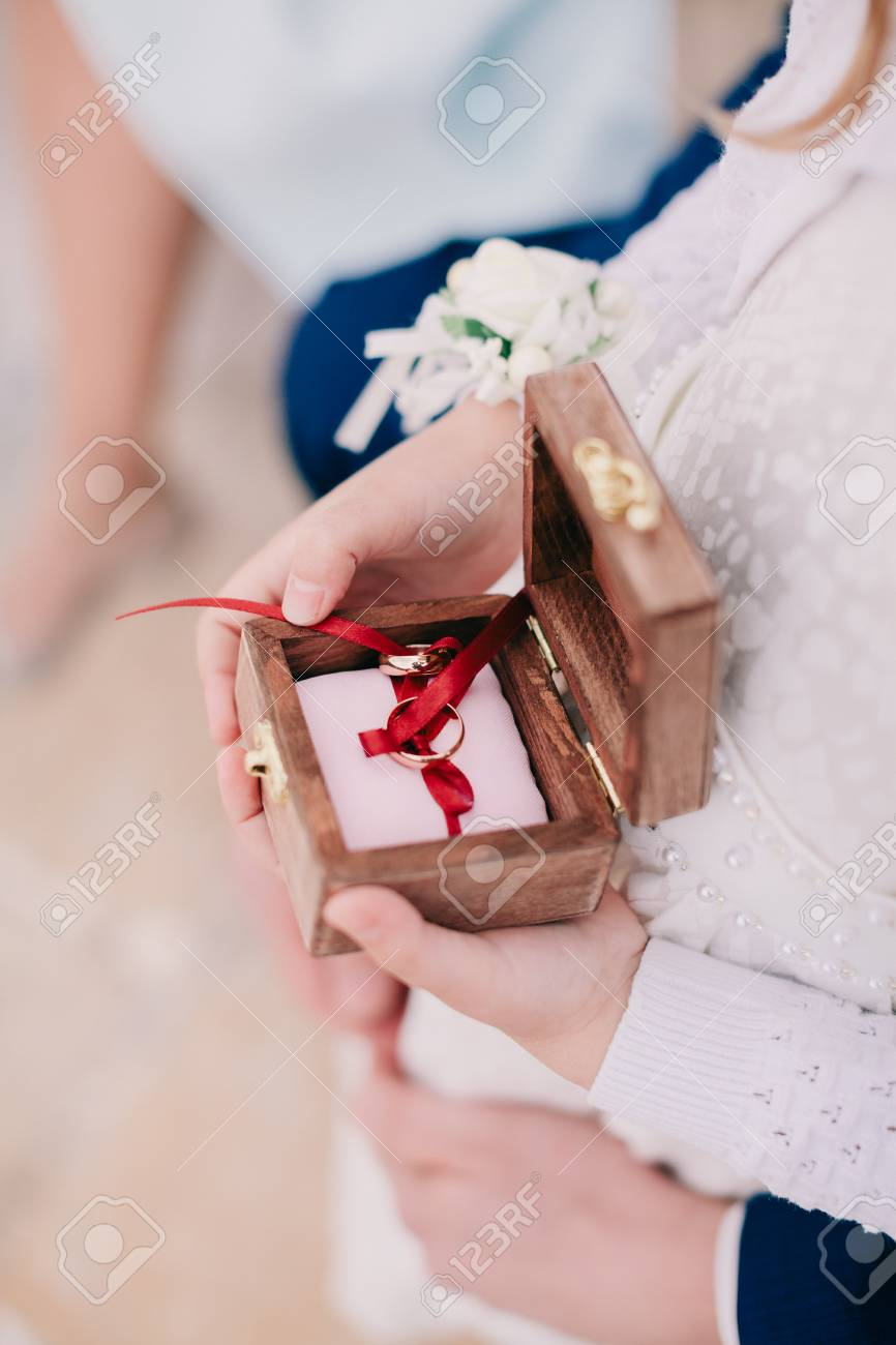 Child Holding Ring Box. Wedding Rings Close Up Stock Photo, Picture ...