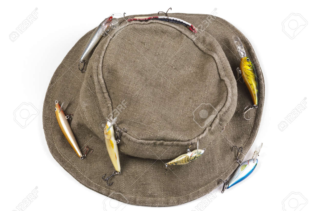 32c51746c A fisherman's hat with lures attached shot against white background..