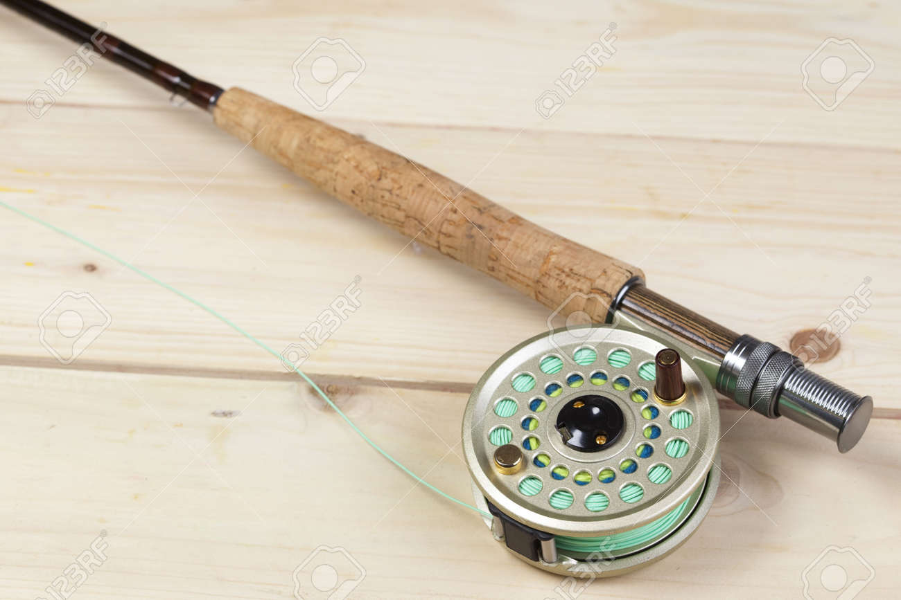 Fly fishing rod and reel with a yellow popping bug Stock Photo - 5787835
