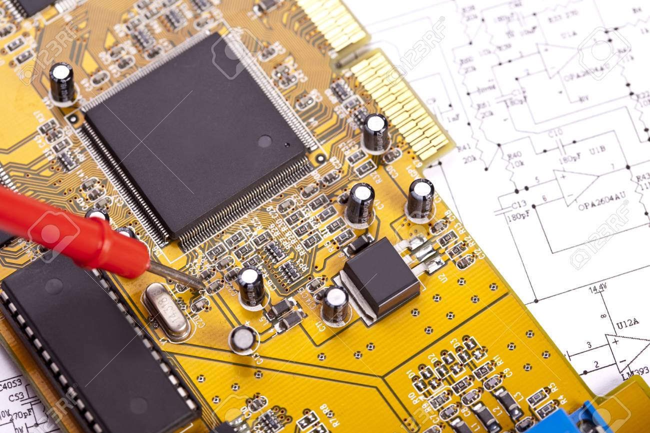 Electronic components on a schematic diagram background. Stock Photo - 8005766