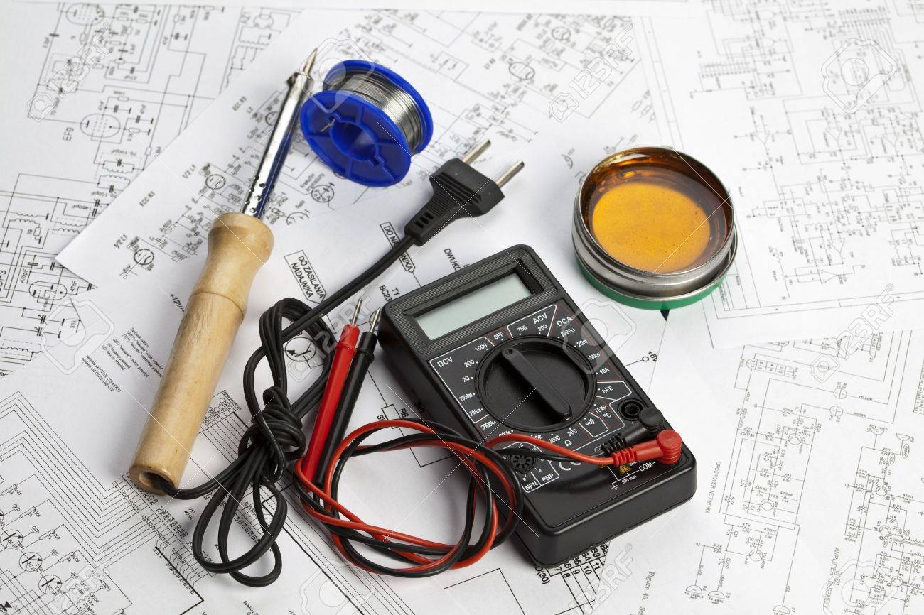 Electronic components on a schematic diagram background. Stock Photo - 8005750