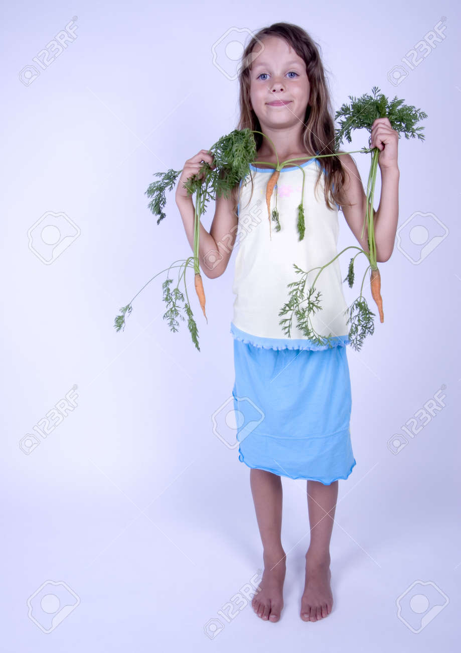 A little girl holding in her hand a beautiful flower Stock Photo - 8022523