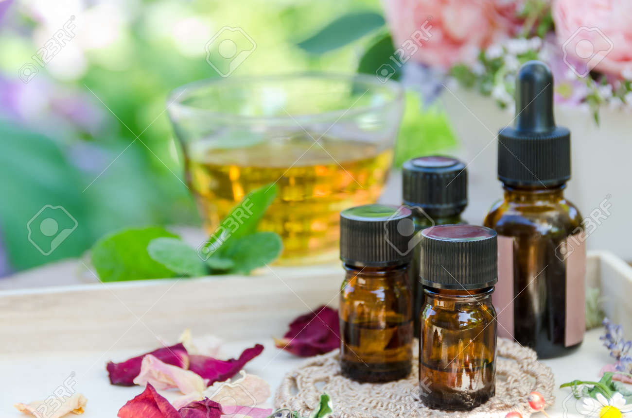 essential oils with herbs for aromatherapy treatment - 40391514