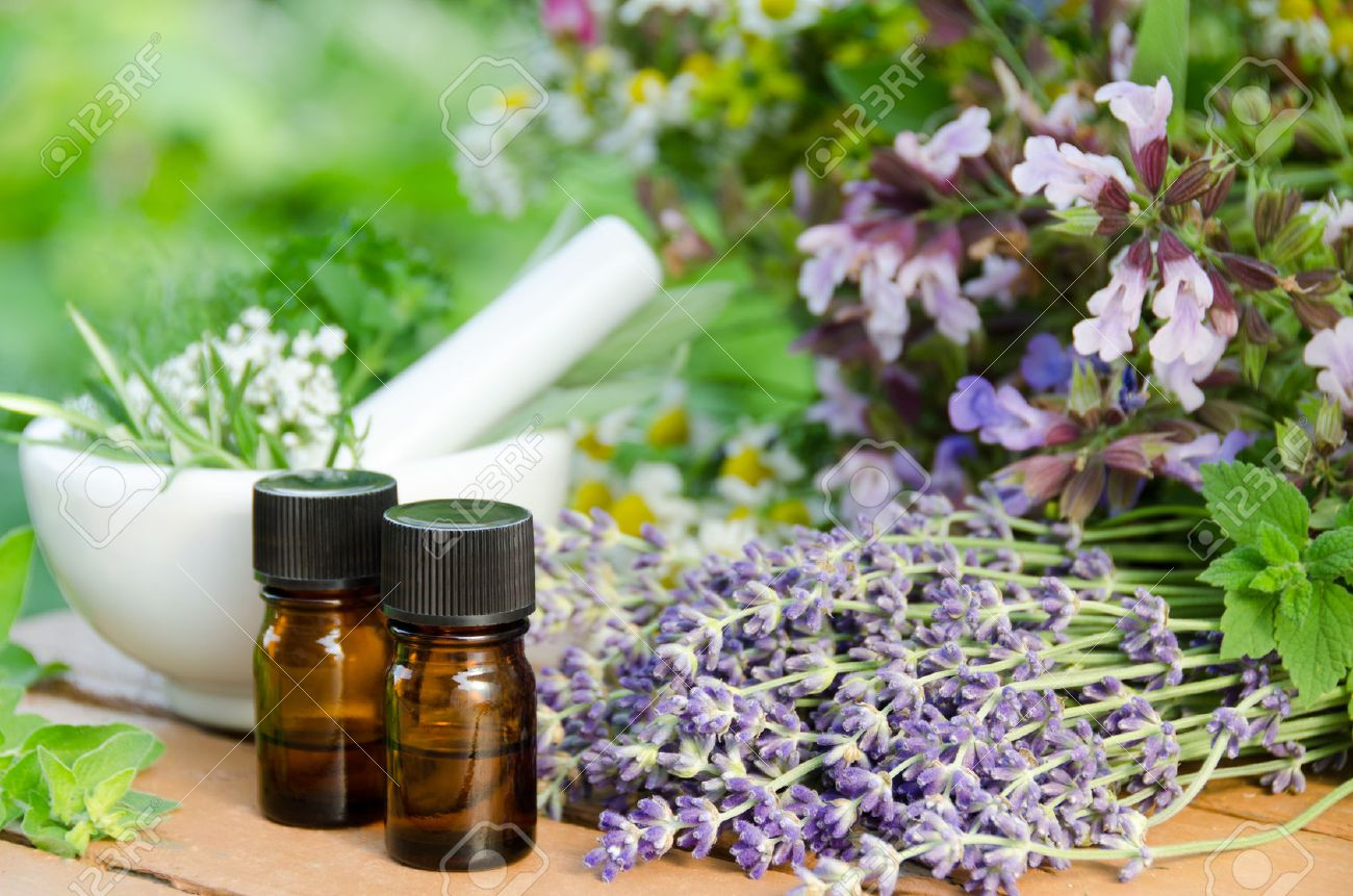 essential oils with herbal flowers for natural therapy - 47461686