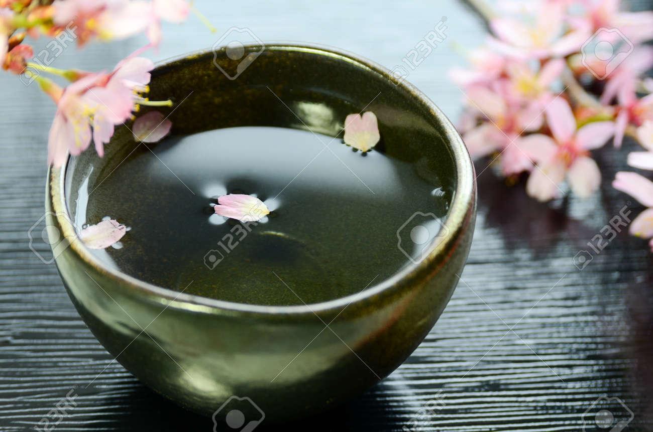 cherry blossom and Japanese rice wine - 56968875