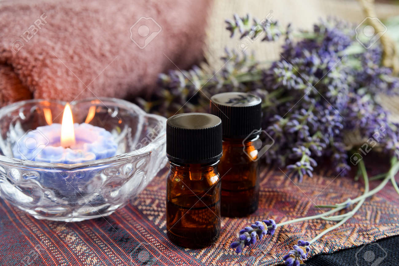 essential oils with lavender in candle light - 61305581