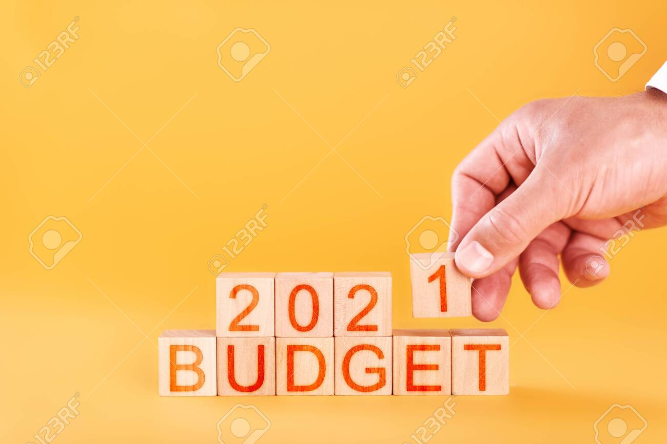 budget 2021 concept. male hand stacks wooden blocks with the inscription budget 2021 - 150534085