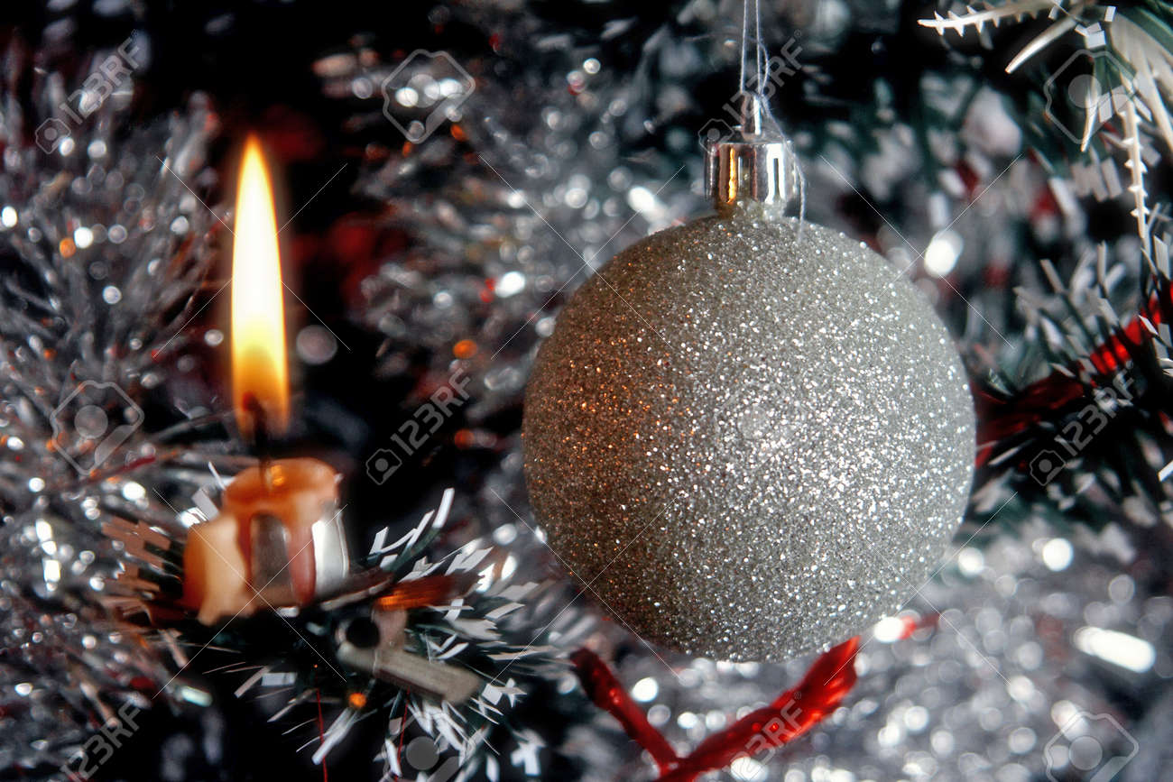 Christmas tree with ornaments, ribbons and candles Stock Photo - 10960428