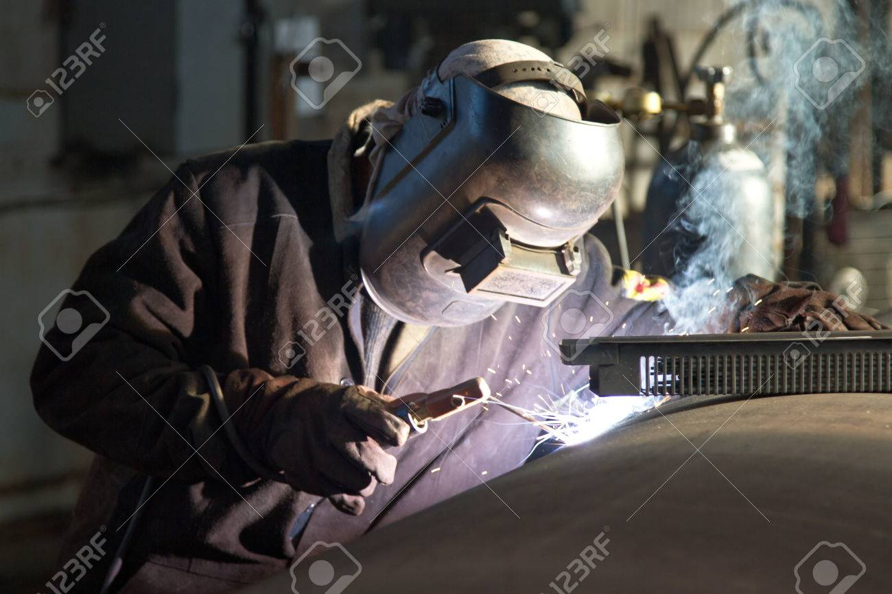 Welder working on welding of shells heat exchanger Standard-Bild - 23017052