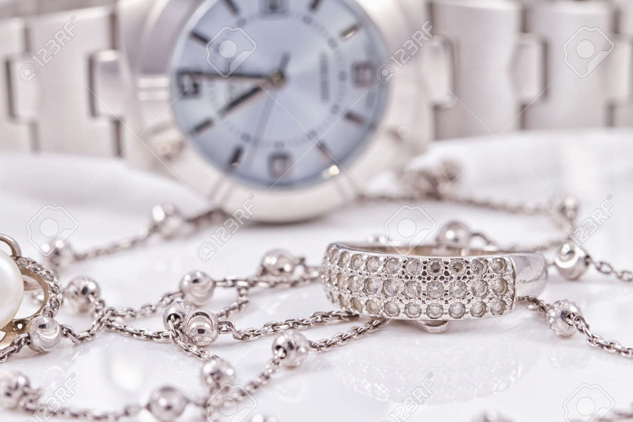 Silver ring and chain on the background of women's watches Standard-Bild - 45646893