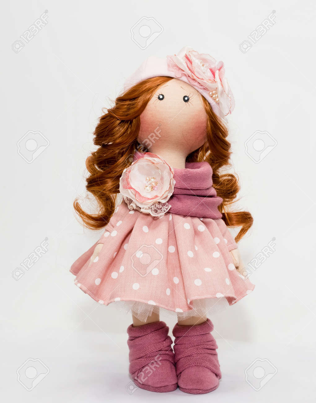 Collectible handmade doll in pink dress with white polka dots in the style of the 50s Standard-Bild - 64579685