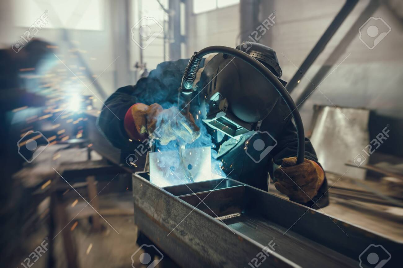 Welder performs welding work of metal structures in a complex spatial position semi-automatic welding - 122393118