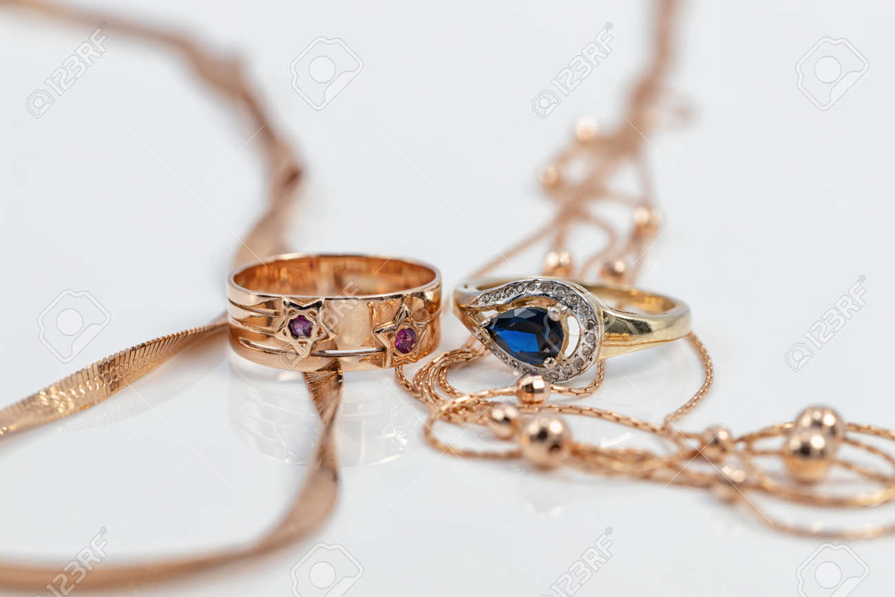 Two different-shaped gold rings with precious stones and two completely different-shaped gold chains - 164953234