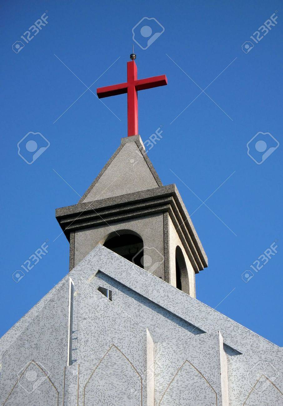New Country Church With A Red Cross Seen Against Blue Sky Stock Photo