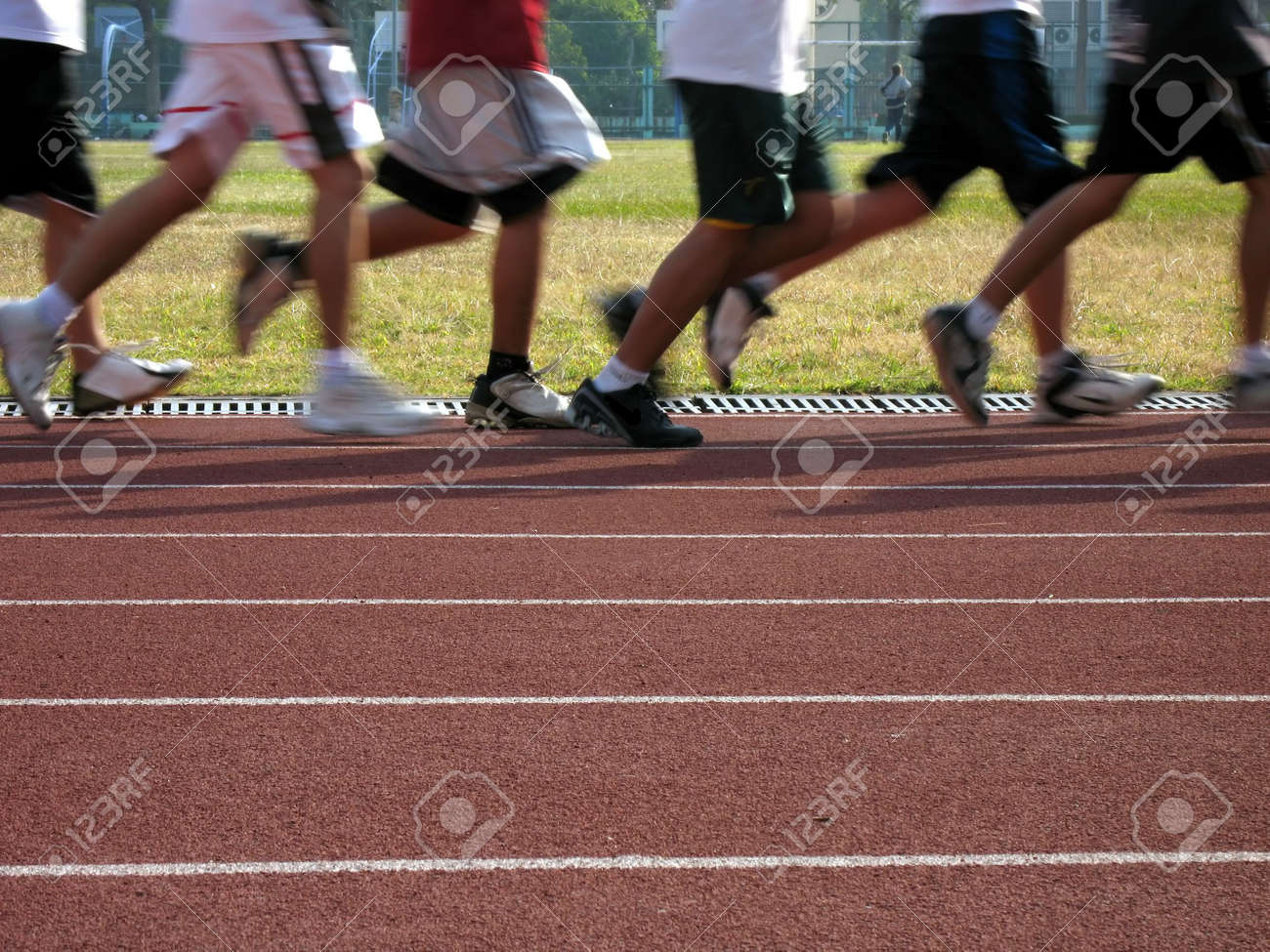 Runners in Motion -- exercising on an outdoor athletic running track Stock Photo - 791724