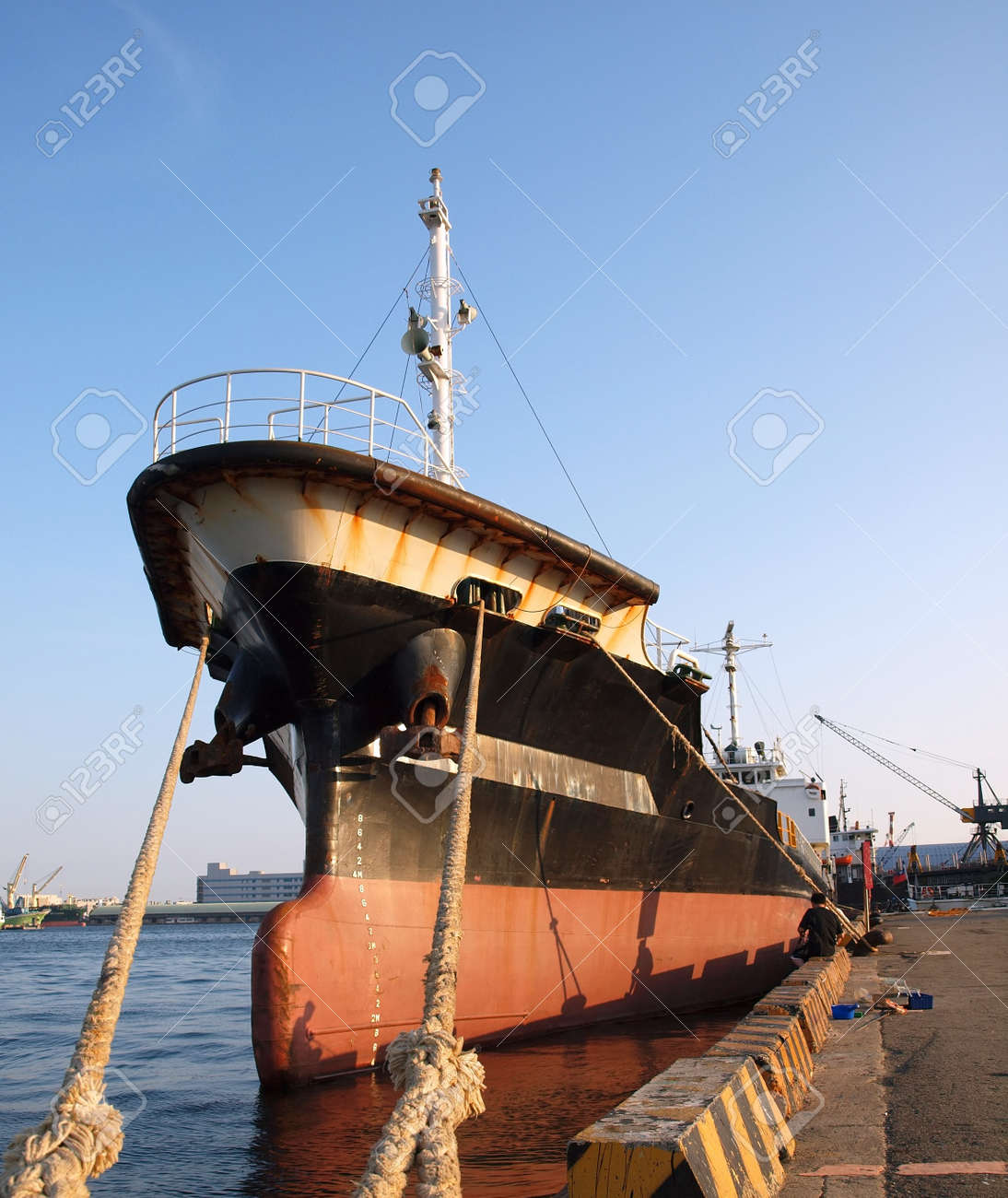 A Black Freight Ship Is Tied Up In Port Stock Photo, Picture And ...