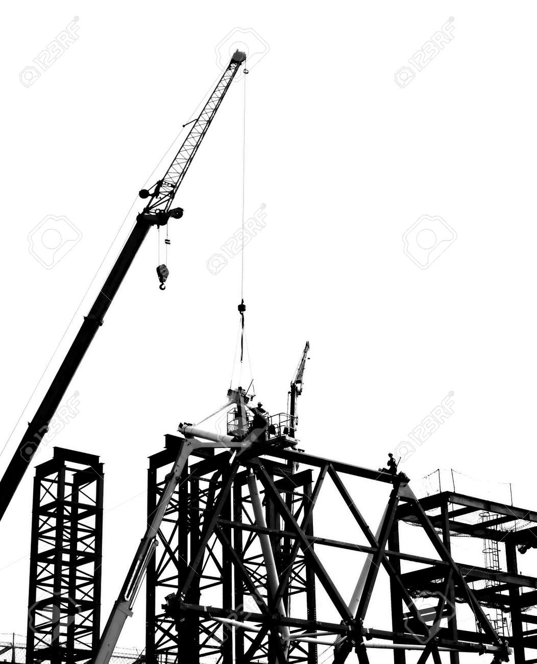 Steel construction with crane and workers in silhouette Stock Photo - 17888930