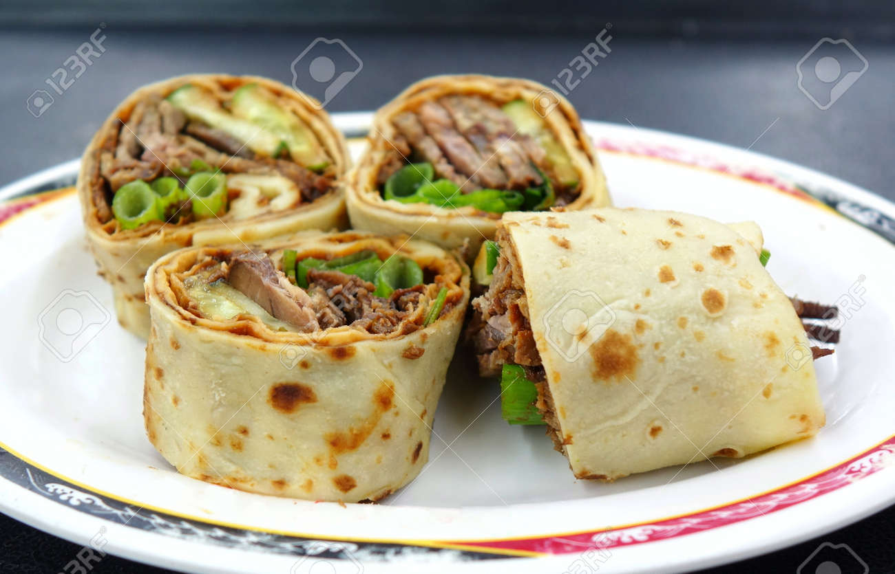 Rolled Pancakes Stuffed With Beef Spring Onions And Sweet Bean Stock Photo Picture And Royalty Free Image Image 112522687