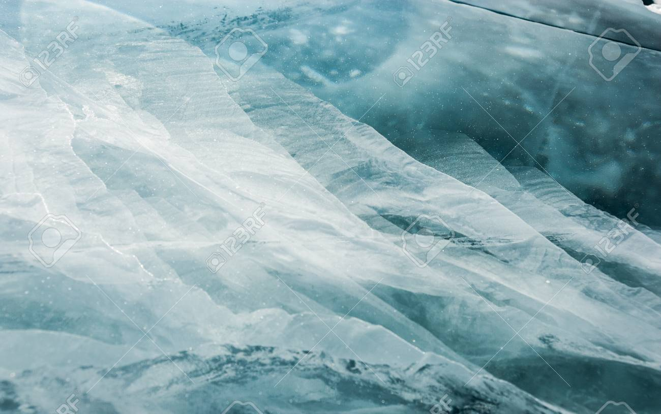 Cracked Black Ice Of Frozen Lake Nature Abstract Background