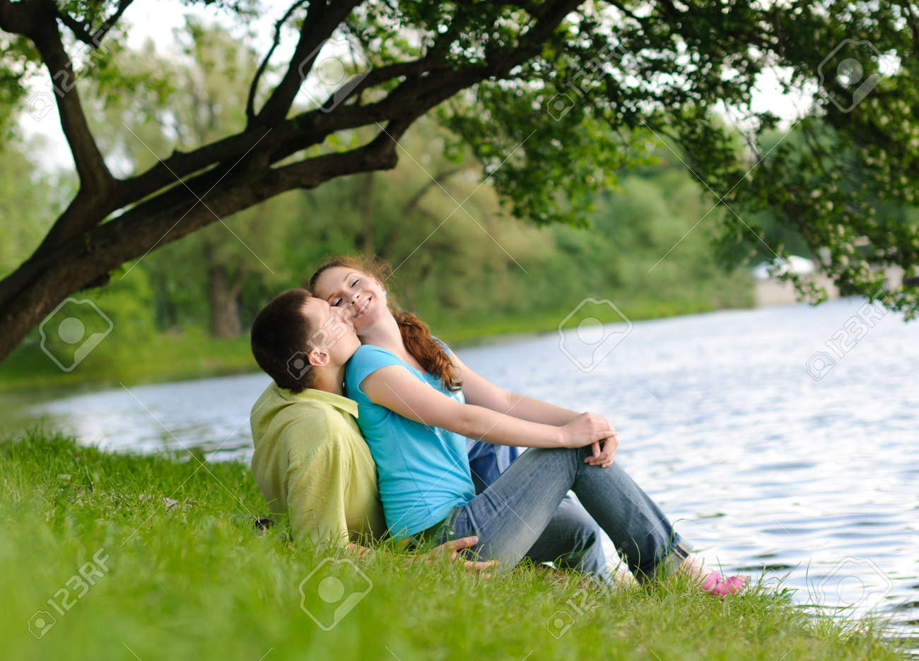 adorable young woman and man in the park Stock Photo - 9828599