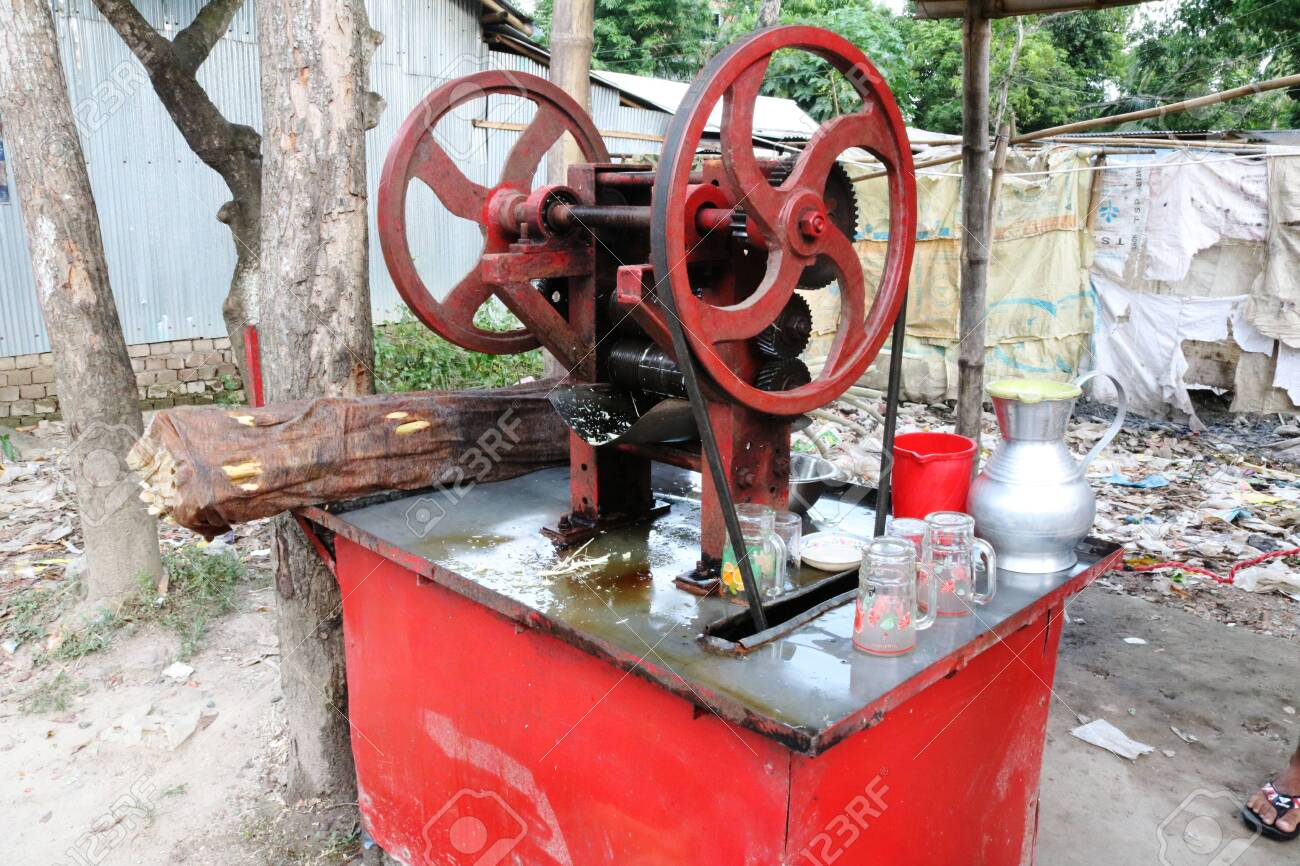 Sugarcane Juice Extractor Machine Red Color Stock Photo Picture And Royalty Free Image Image 136126284