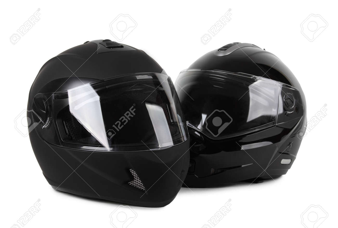 two black motorcycle helmets isolated Stock Photo - 13227168