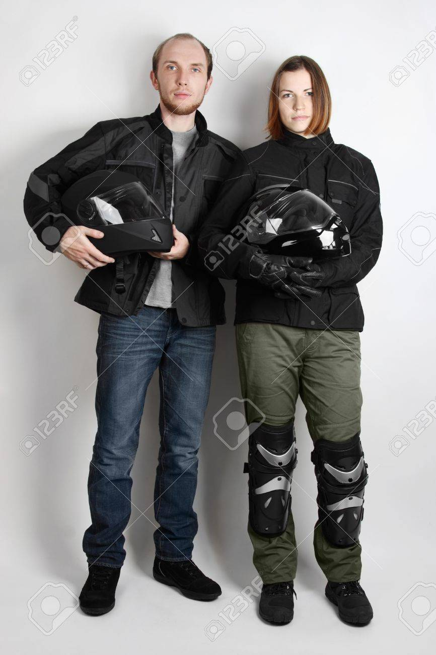 young motorcyclists man and woman holding helmets in studio Stock Photo - 14162238