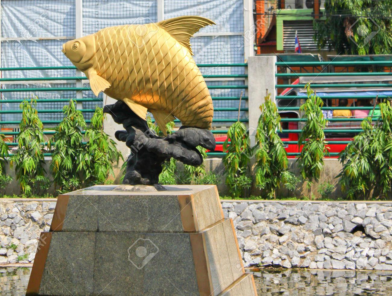 Golden fish , java barb sculpture Stock Photo - 13810878