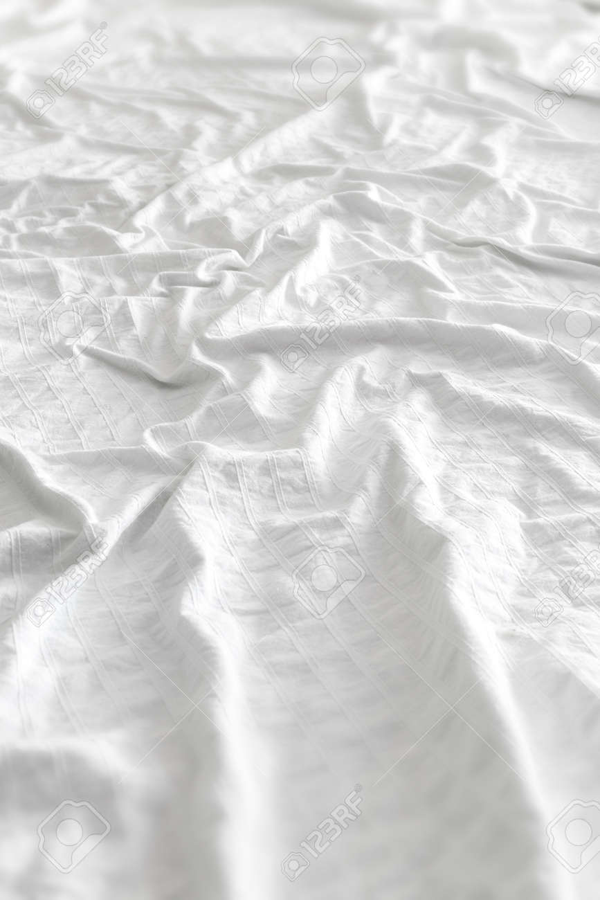 White bed sheet background - Stock Photo Very Comfortable White Bed Sheet Background