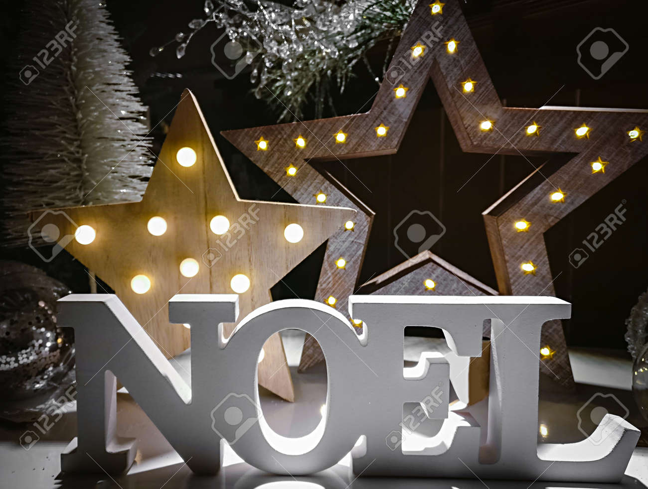 Noel Word Made Of Wooden Letters On A Background Illuminated