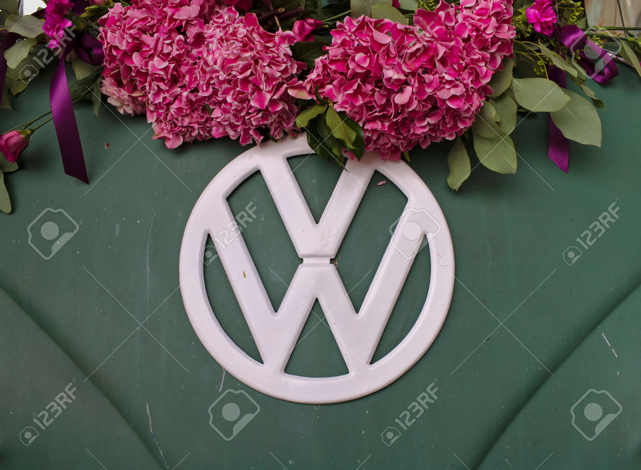 Bremen Germany July 17th 2018 Close Up Photo Of The Front Of A Green Vw T3 Van With White Vw Logo Decorated With Pink Flowers