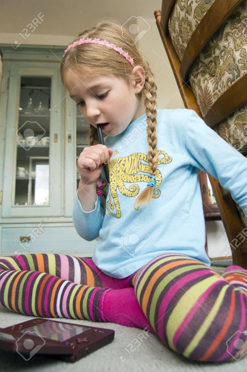 little girl learning on mini computer Stock Photo - 13901109