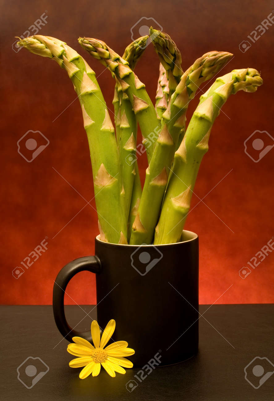 Food Ingredients - Vegetables - Cup with asparagus. Stock Photo - 8131104